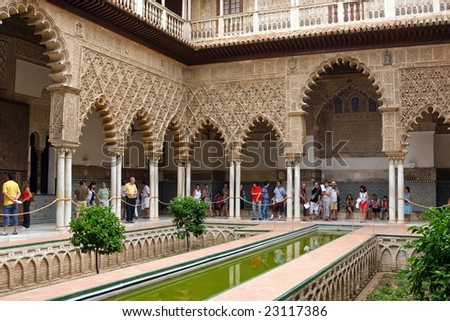 Alcazar, Sevilla, Spain - JULY 20, 2008: Alcazar in Sevilla is one of biggest tourist attraction sites in Europe. Hundreds of people from around the world visit this architecture monument daily.