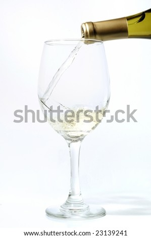 alcohol being poured into a glass - stock photo