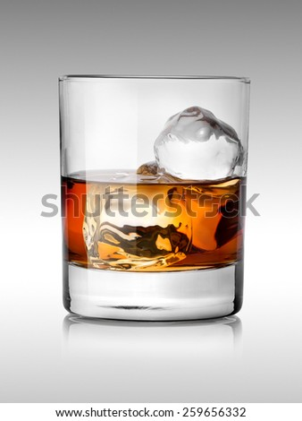 Alcohol beverage with ice isolated on white - stock photo