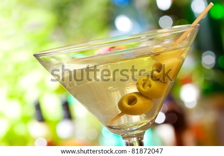 Alcohol cocktail martini with olives - stock photo