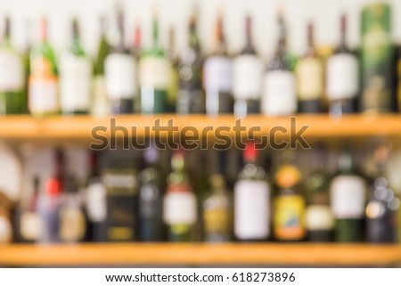 Alcohol drink bottle blurred out of focus background