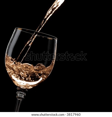 Alcohol drink pours into the glass. Blank space on the right - stock photo