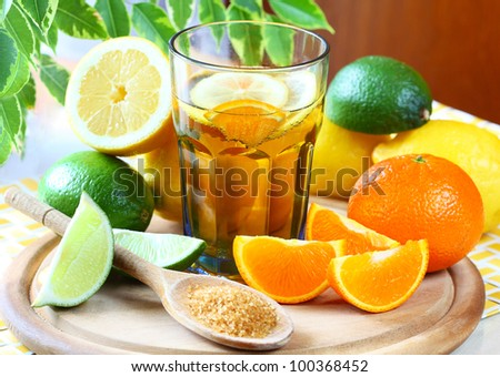 Alcohol drink with lemon, lime and orange. - stock photo