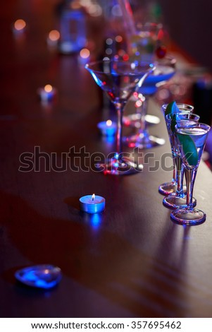 Alcohol drinks standing on the cocktail bar - stock photo