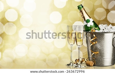 Alcohol. Flutes of champagne in holiday setting - stock photo