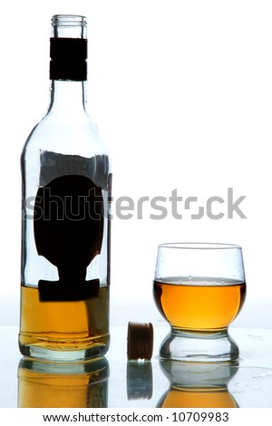 alcohol in bottle and glass on table, white background - stock photo