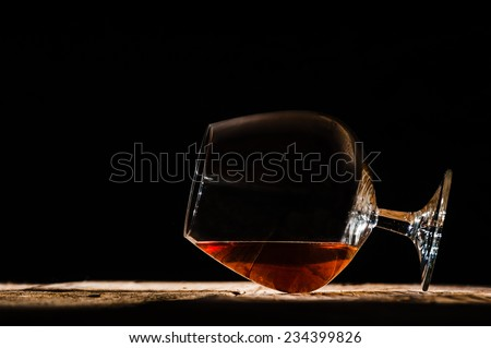 Alcohol in large round glass, Whisky, Brandy, Cognac - stock photo