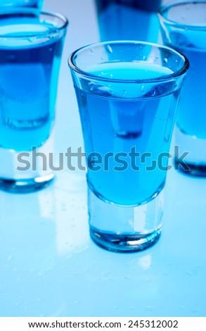 Alcohol in shot glasses - stock photo