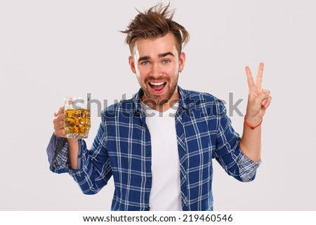 Alcohol, problems. Young alcoholic with beer - stock photo