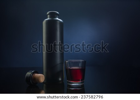 alcohol tincture on a dark background - stock photo