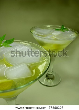 alcohol yellow liqueur cocktail with ice and lemon - stock photo