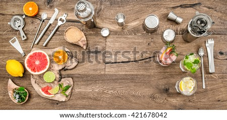 Alcoholic and nonalcoholic drinks with ice. Cocktail making bar tools, shaker, glasses. Flat lay.Top view - stock photo
