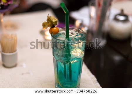 alcoholic cocktail against the background of the table - stock photo