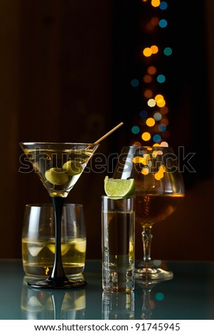 Alcoholic drinks in a bar on a glass table. - stock photo