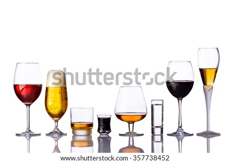 alcoholic drinks in a row isolated on white background - stock photo