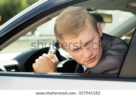 Alcoholic driving a car