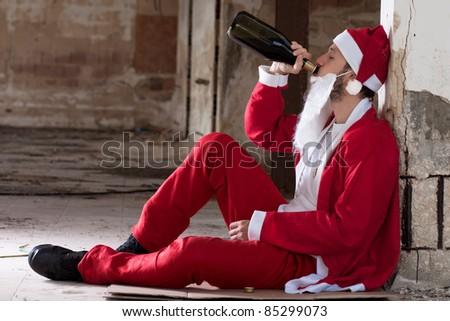 Alcoholic Santa Drinking a Wine Bottle - stock photo