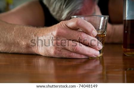 alcoholism - depressed man with whiskey - stock photo
