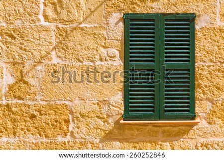Alcudia Old Town mediterranean wood window shutters Mallorca Balearic island of Spain - stock photo