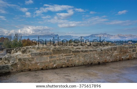 Alcudia wall and mountains - stock photo