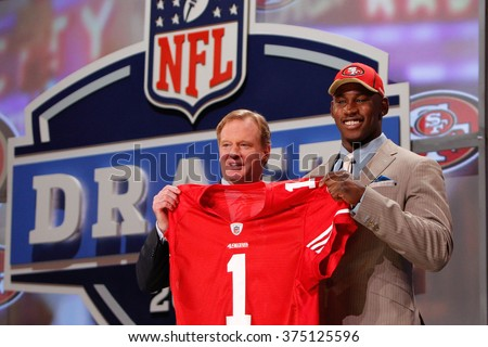 Aldon Smith is introduced by Commissioner of the National Football League Roger Goodell as the seventh pick to the San Francisco 49ers at the NFL Draft 2011 at Radio City Music Hall in New York, NY. - stock photo