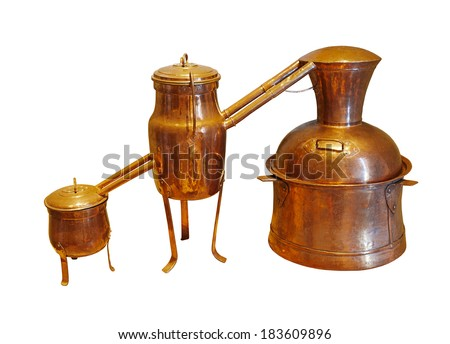 Alembic Copper - Distillation apparatus employed for the distillation of alcohol, essential oils and moonshine. Vintage wine distillery for the home made of the wine isolated on white. - stock photo