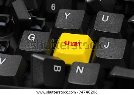 alert word on yellow and black keyboard button - stock photo
