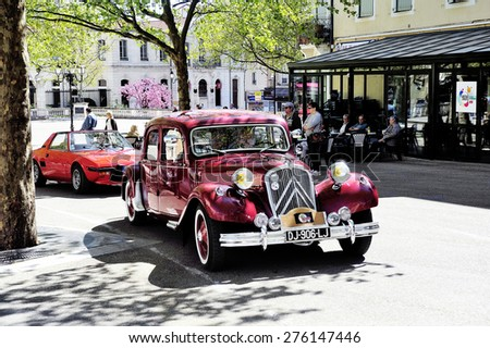 ALES, FRANCE - APRIL 11: Citroen front-wheel Drive red photographed vintage car rally Town Hall Square in the town of Ales, April 11, 2015. - stock photo