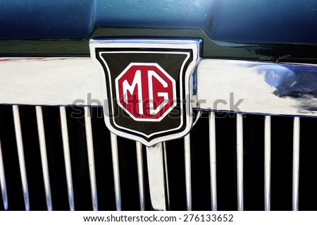 ALES, FRANCE - APRIL 11: Detail of the MG brand on an old car radiator photographed vintage car rally Town Hall Square in the town of Ales, in the Gard department, April 11, 2015. - stock photo