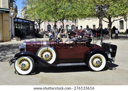ALES, FRANCE - APRIL 11: old car photographed at the rally of vintage cars Town Hall Square in the town of Ales, in the Gard department, April 11, 2015. - stock photo