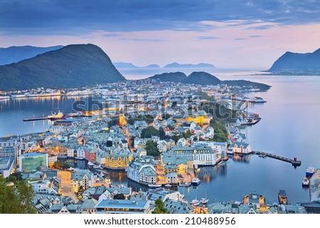 Alesund, Norway. Image of norwegian city of Alesund during twilight blue hour. - stock photo