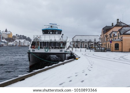 ALESUND, NORWAY- January 07, 2018: Ferry in the port of Alesund. Alesund is a sea port, and is noted for its concentration of Art Nouveau architecture.
