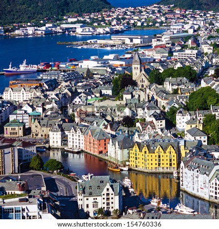 Alesund, Norway - town houses on sea front - stock photo