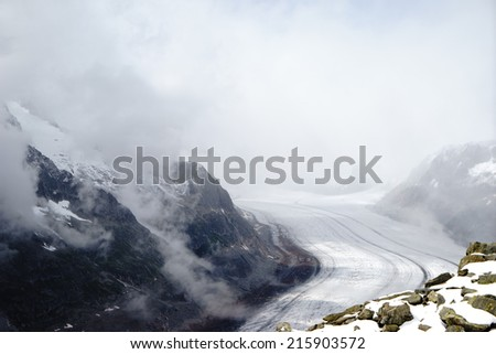 Aletsch glacier in cloud, at Swiss - stock photo