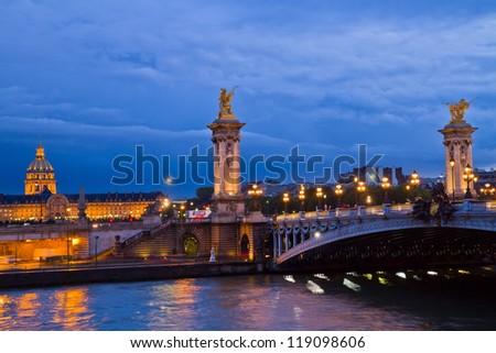 Alexandre III Bridge at night in  Paris, France - stock photo
