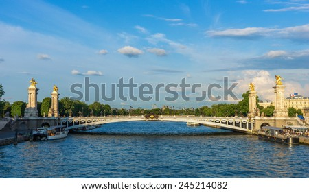 Alexandre III bridge (Pont Alexandre III) during dramatic sunset, Paris, France - stock photo