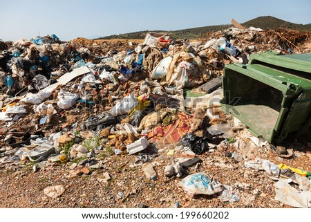 ALEXANDROUPOLIS, GREECE - MARCH 30: A section of a landfill located on March 30, 2014 in Alexandroupolis, Greece. Though forbidden this way for the municipality garbage, still exists.