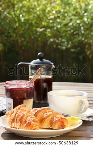Alfresco breakfast with selective focus on foreground - stock photo