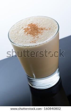 Algarrobina cocktail, Peruvian drink make with milk, pisco, ice and algarrobina. - stock photo