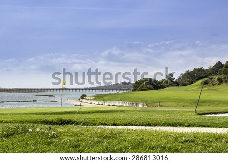 Algarve golf course seascape scenery, at Ria Formosa wetlands reserve, famous golf and nature destination, southern Portugal. - stock photo
