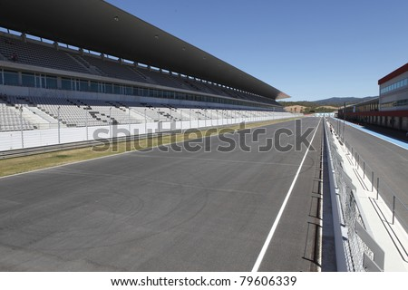 ALGARVE - JULY 12: Empty car track and  bleachers before car racing, July 12, 2009 in Portimao, Algarve, Portugal.
