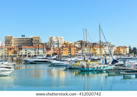 Algarve, Portugal - April 18, 2016: Beautiful sunny view of Marina de Vilamoura, yachts boats on the background - stock photo