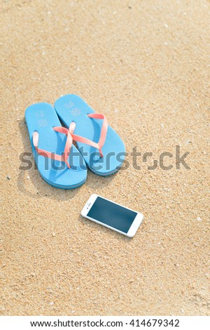 Algarve, Portugal - April 30, 2016: Closeup on iPhone 6 smartphone on the beach background. Top view flat lay style, photo and video outside
