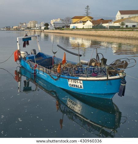 ALGARVE, PORTUGAL - January 27, 2016: Fishing boat docked in Ria Formosa in Faro. Nature, Travel and Vacations - stock photo