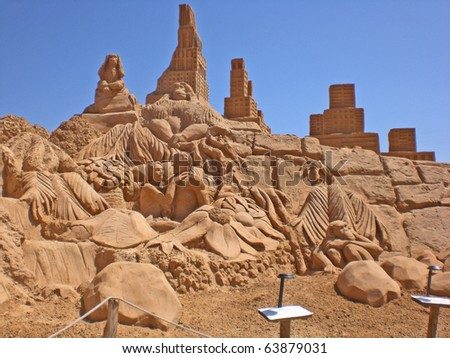 ALGARVE, PORTUGAL - JUNE 28: An exhibition of sand sculptures, Maugli, on june 28, 2008 in Algarve, Portugal. Life of sand sculptures some days, but art of adequately long life. - stock photo