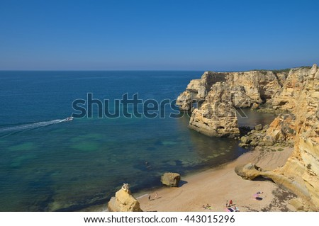 ALGARVE, PORTUGAL - June 25, 2016: Summertime in Carvoeiro by the cliffs. Travel and vacation destinations - stock photo