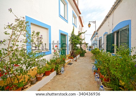 Algarve: Traditional houses in the fishing village of Ferragudo near Portimao, Portugal Europe - stock photo