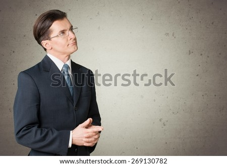Algebra. Handsome young school boy thinking about complex mathematical signs - stock photo
