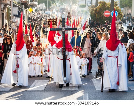 Algeciras, Spain - 20 March, 2016 Participants of the Palm Sunday procession. The penitents wear the typical conical hoods