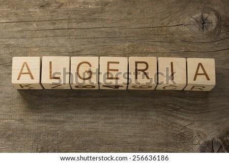 Algeria on a wooden background - stock photo